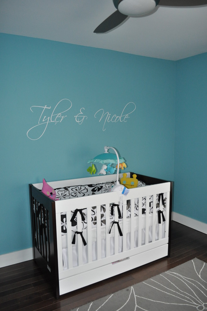 4 in 1 Convertible Crib Nursery Modern with Area Rug Baseboards Blue Walls Ceiling Fan Crib Crib Accessories Dark Floor