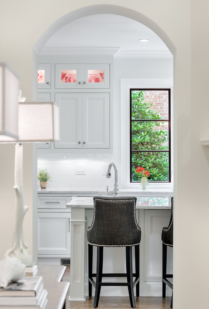 Abbyson Living Kitchen Traditional with Arched Doorway Black and White Cabinet Lighting Counter Stools Glass Front Cabinets
