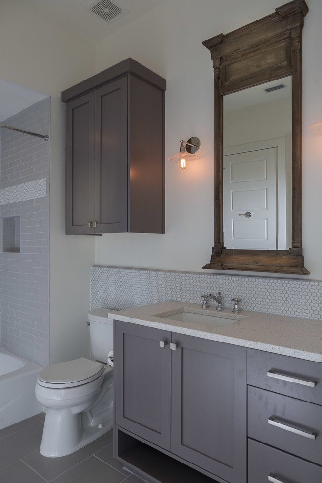 Above Toilet Cabinet Bathroom Contemporary with Caesarstone Gray Cabinets Grey Cabinets Penny Round Tile Sconce Shaker Cabinets Small