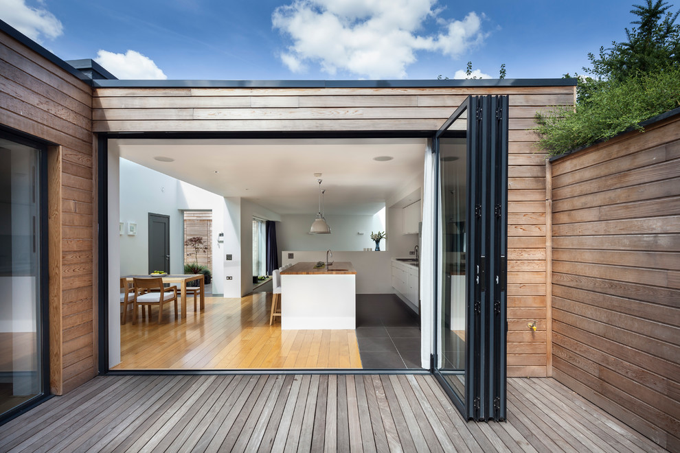 all clad non stick Patio Contemporary with black framed glass bi-fold doors decking dining room flat roof flat-top roof