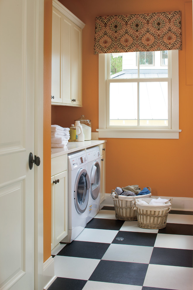 alterna flooring Laundry Room Traditional with black and white checker floor built in storage front loading washer and