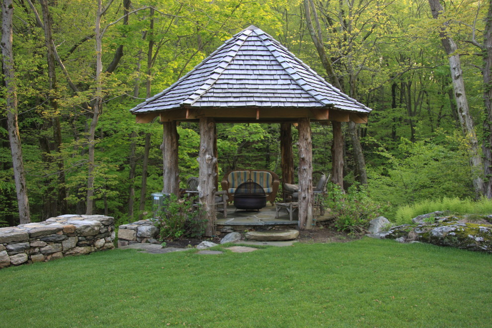 Aluminum Gazebo Patio Rustic with Flagstone Path Grass Lawn Log Posts Low Garden Wall Outdoor Fire Pit