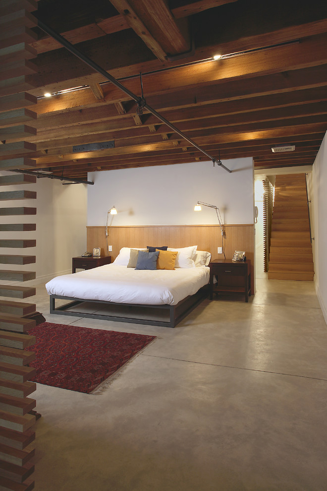 Amisco Bedroom Industrial with Concrete Floor Exposed Pipes Loft Platform Bed Red Rug Wall Sconces
