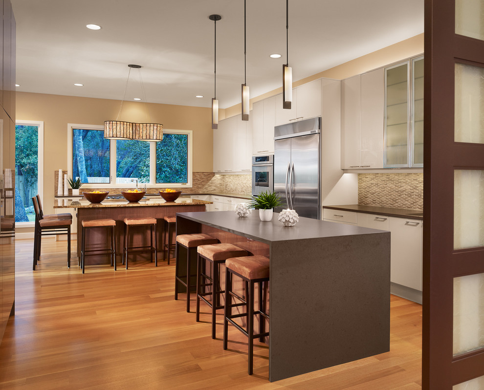 Amisco Kitchen Contemporary with Beige Walls Glass Front Cabinets Granite Kitchen Island Pendant Lights Stainless Steel