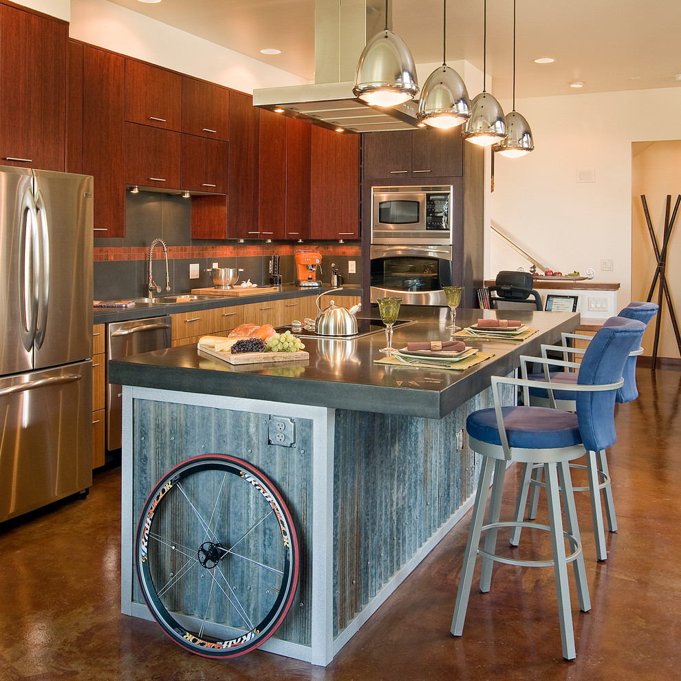 amisco Kitchen Industrial with beige wall cooktops counter stools doorway pendant lighting polished concrete floor pony
