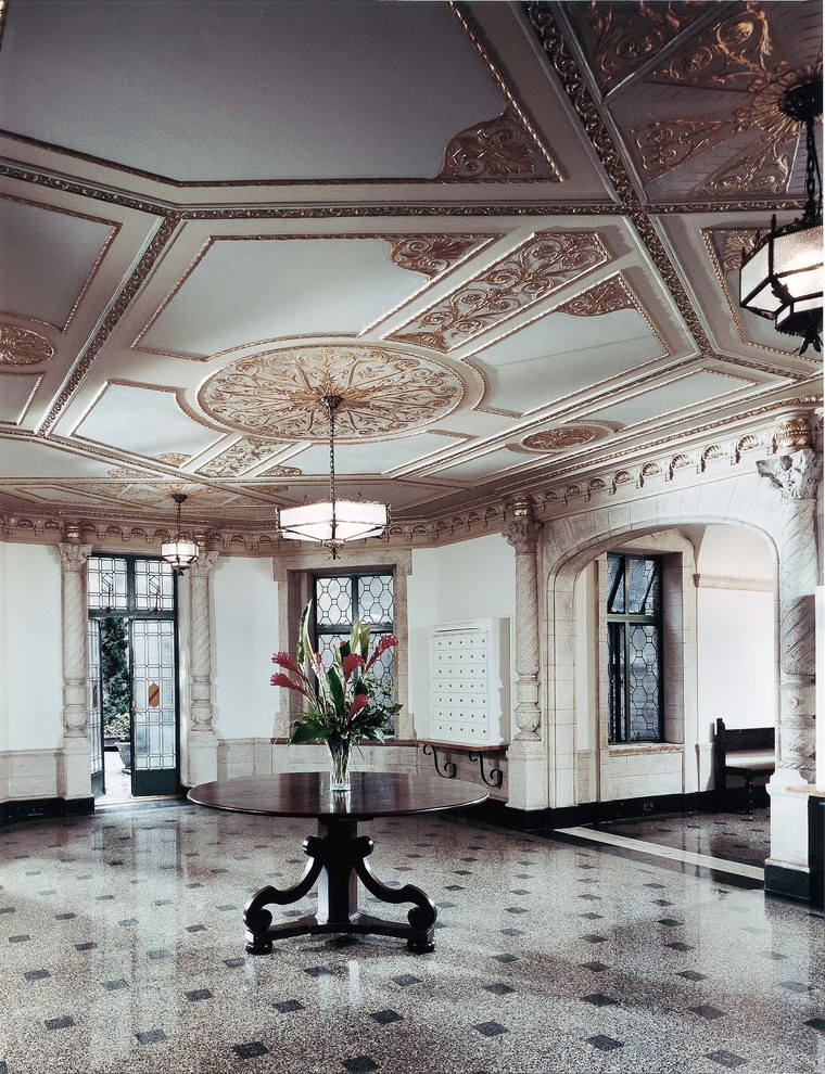 apartment mailboxes Entry Traditional with ceiling lighting ceiling medallion centerpiece columns crown molding entry table floral arrangement