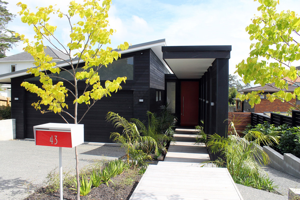 Apartment Mailboxes Exterior Contemporary with Black Exterior Black Garage Door Black Siding Bushes Butterfly Roof Clerestory Window