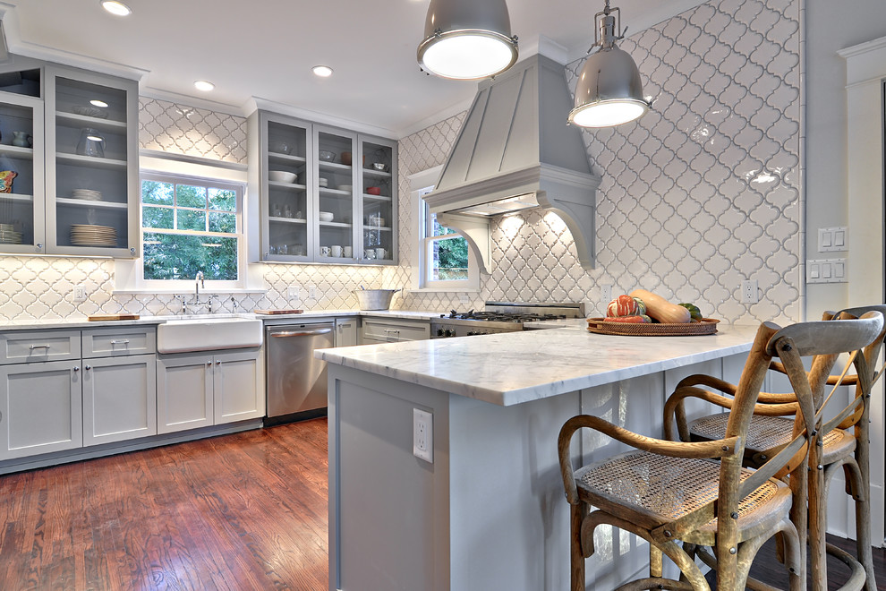 arabesque tile Kitchen Traditional with Arabesque Tile Carrara marble counter stools Custom Cabinetry farmhouse sink glass panel