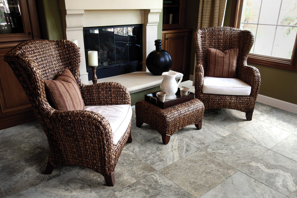 Armless Sofa Living Room with Black Vase Brown Accents Cozy Cream Cushions Fireplace Gray Floor Tiles Green