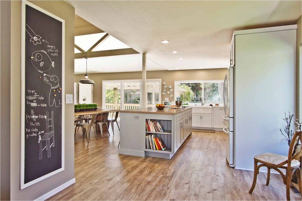 armstrong luxe plank Kitchen Contemporary with Caesarstone countertops ceiling lights chalkboard exposed beams kitchen countertops kitchen island neutral