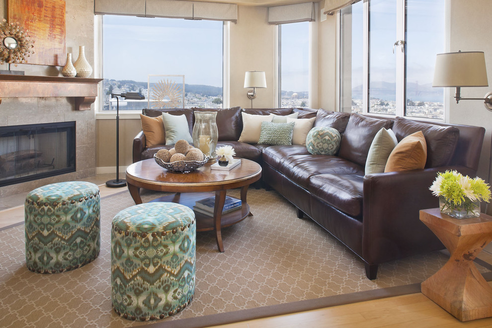 Ashley Furniture Leather Sectional Family Room Traditional with Accent Tables Area Rug Brown Leather Couch Coffee Table Fireplace Mantle Nail