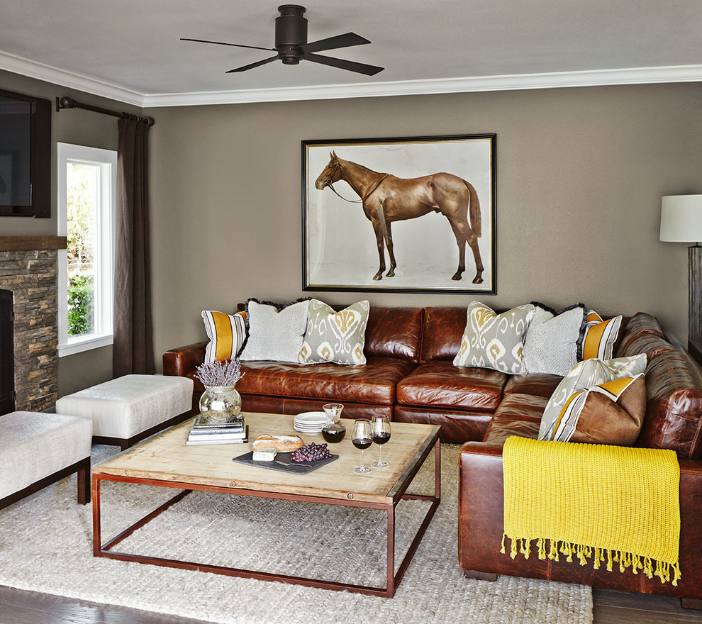 Ashley Furniture Leather Sectional Living Room Transitional with Braided Rug Ceiling Fan Decorative Pillows Horse Art Leather Sectional Ottomans Reclaimed