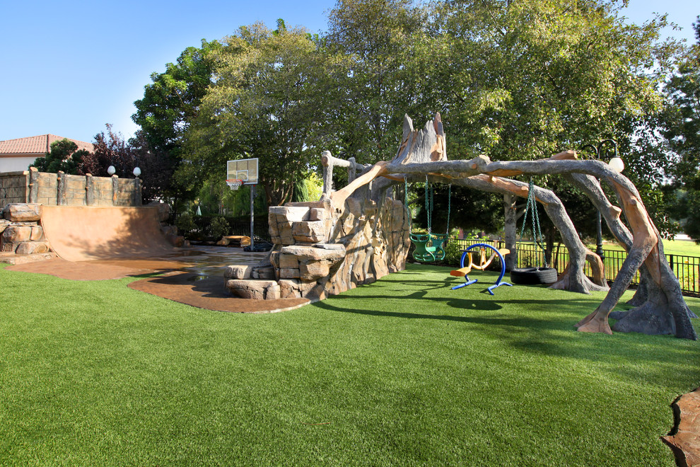 Backyard Playground Equipment Landscape Contemporary with Basketball Court Fence Grass Outdoor Play Sets Stone Wall Trees