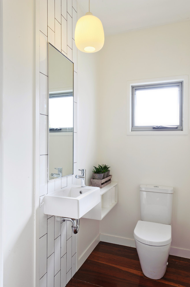Bathroom Etagere Powder Room Contemporary with Dark Wood Floor Floating Shelf Small Sink Square Sink Vertical Subway Tiles