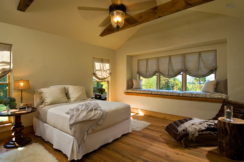 Bathroom Fan Motor Bedroom Rustic with Beams Bed Blinds Ceiling Fan Chaise Lounge Pedestal Table Rug Traditional Vaulted
