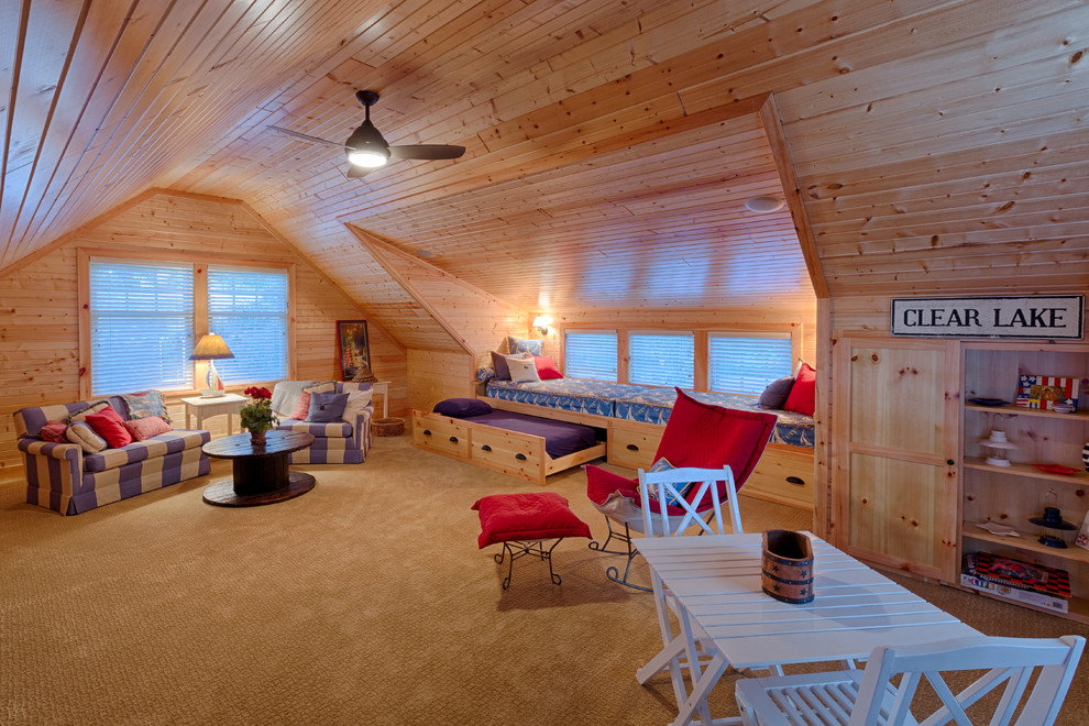Bed with Trundle Family Room Beach with Attic Blinds Blue and White Built in Cabinets Ceiling Fan Knotty Pine Nautical