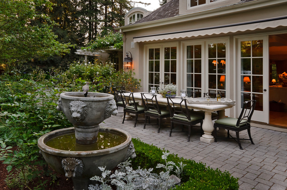 Bird Bath Fountain Patio Mediterranean with Atherton Awning Backyard Fountain French Country Galli Hedge Lanterns Outdoor Dining Outdoor