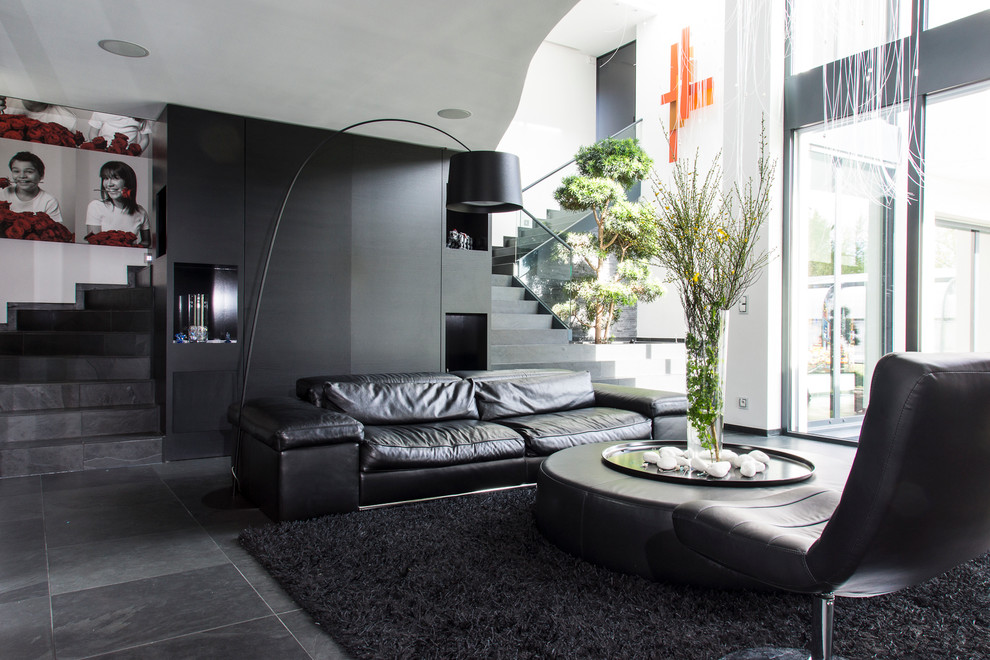 black shag rug Living Room Contemporary with arching floor lamp baies vitres black and white black leather sofa black