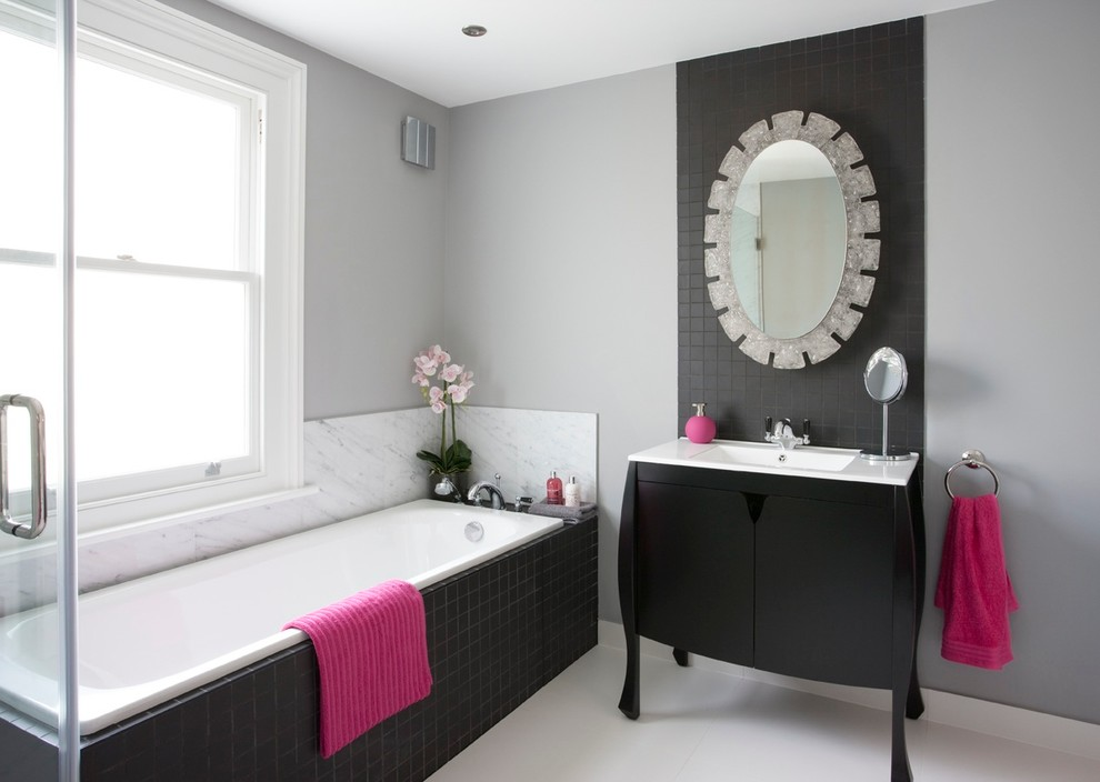 Bombe Chest Bathroom Transitional with Bath Panel Black and White Bathroom Black Tile Accent Wall Black Tile