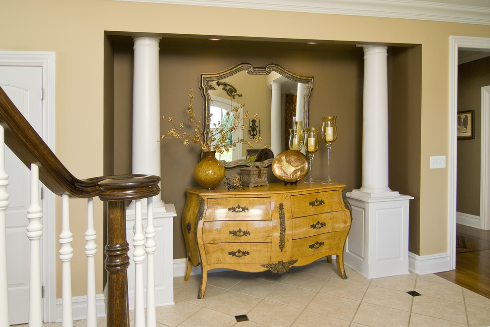 bombe chest Entry Traditional with accent wall banister baseboards bombe chest columns crown molding entry table handrail
