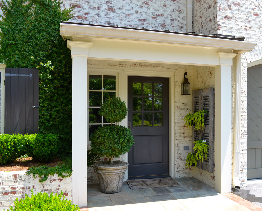 Boxwood Topiary Entry Traditional with Black Front Door Carriage Doors Covered Entry Ferns Louvered Shutters Muntins Painted