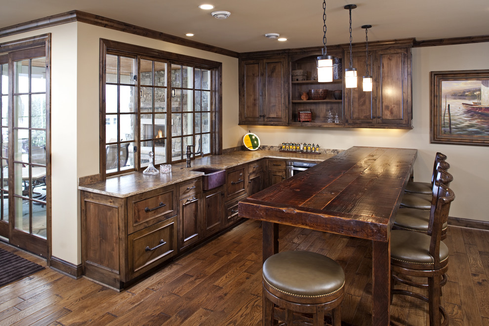 brainerd hardware Kitchen Rustic with apron sink beige counter stools dark stained wood dark wood trim french