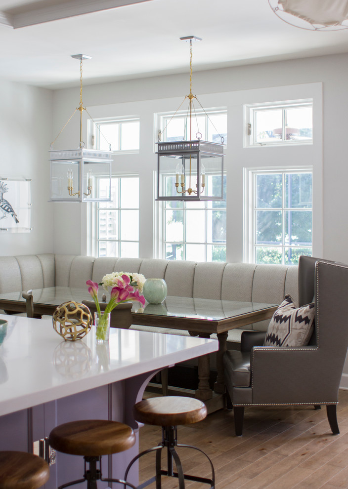breakfast nook table Dining Room Transitional with banquette seating breakfast area built-in bench lanterns row of windows