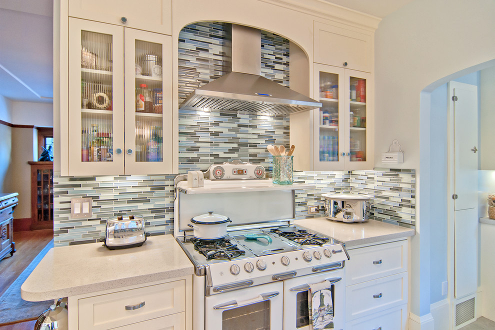 Breville Juicers Kitchen Traditional with Antique Arch Blue Walls Clean Glass Glass Tile Glass Front Appliances Light Matchstick