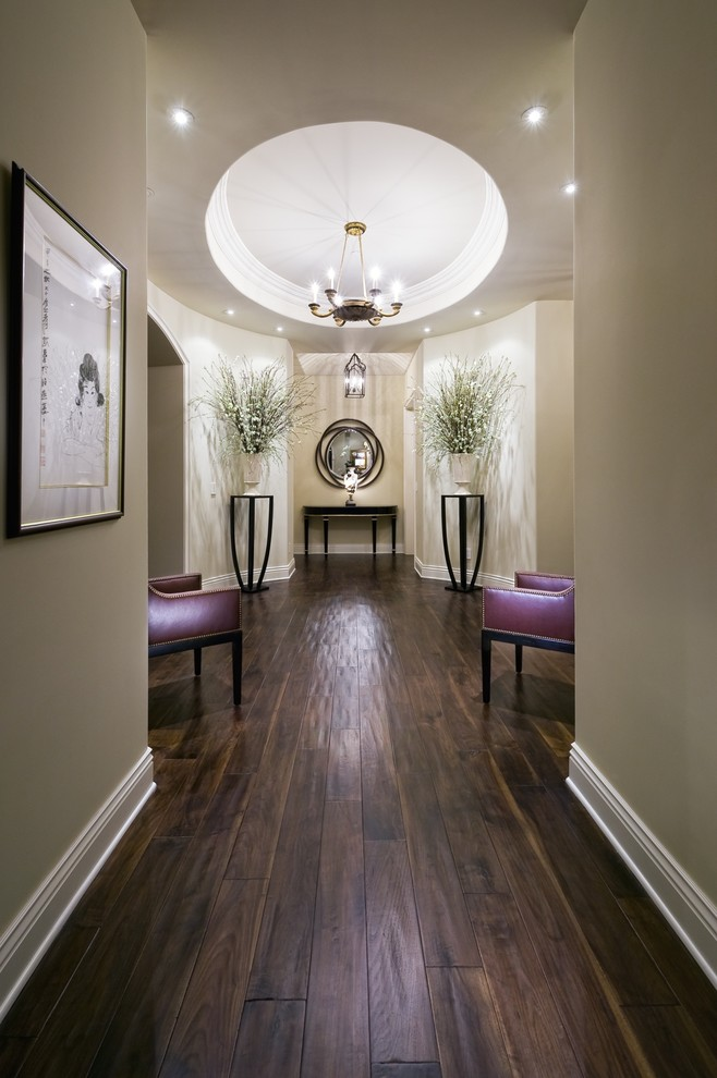 Bruce Wood Flooring Hall Contemporary with Artwork Baseboards Ceiling Lighting Chandelier Console Table Dark Floor Decorative Urns Floral