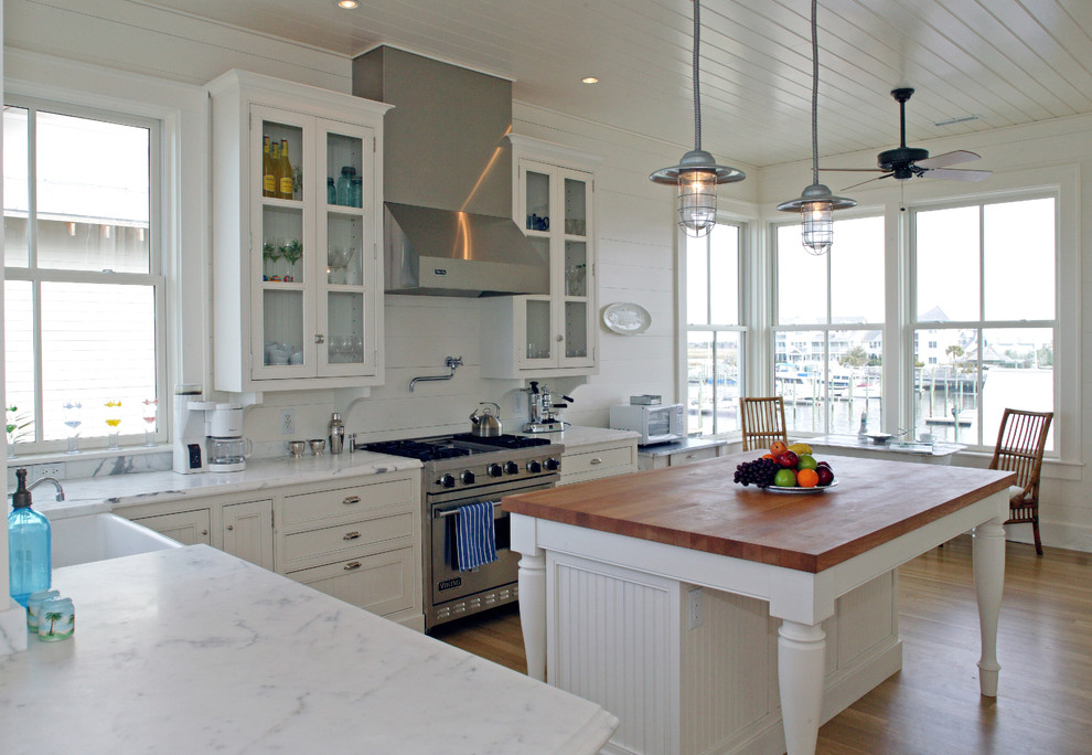 Butcher Block Island Kitchen Traditional with Ceiling Fan Eat in Kitchen Glass Cabinets Industrial Lighting Marble Countertop Range Hood