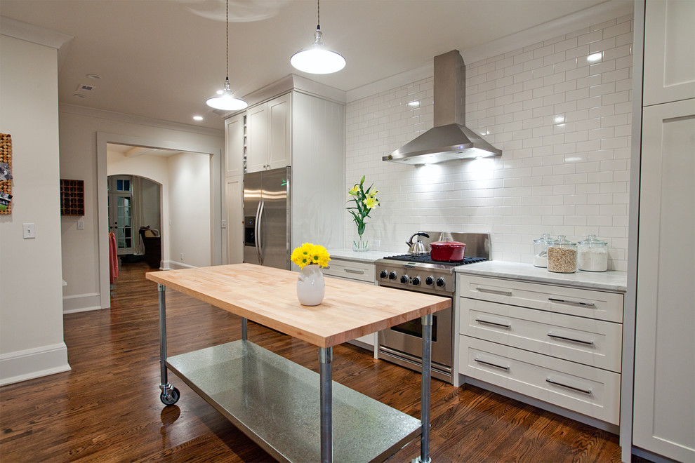 Butcher Block Tables Kitchen Contemporary with Baseboards Butcher Block Countertops Crown Molding Glass Canisters Island Lighting Kitchen Cart
