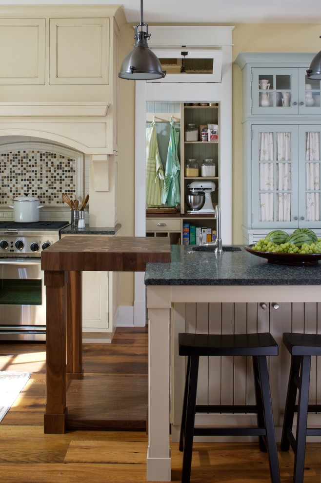 Butcher Block Tables Kitchen Traditional with Breakfast Bar Butcher Block Countertops Eat in Kitchen Hopper Window Kitchen Island