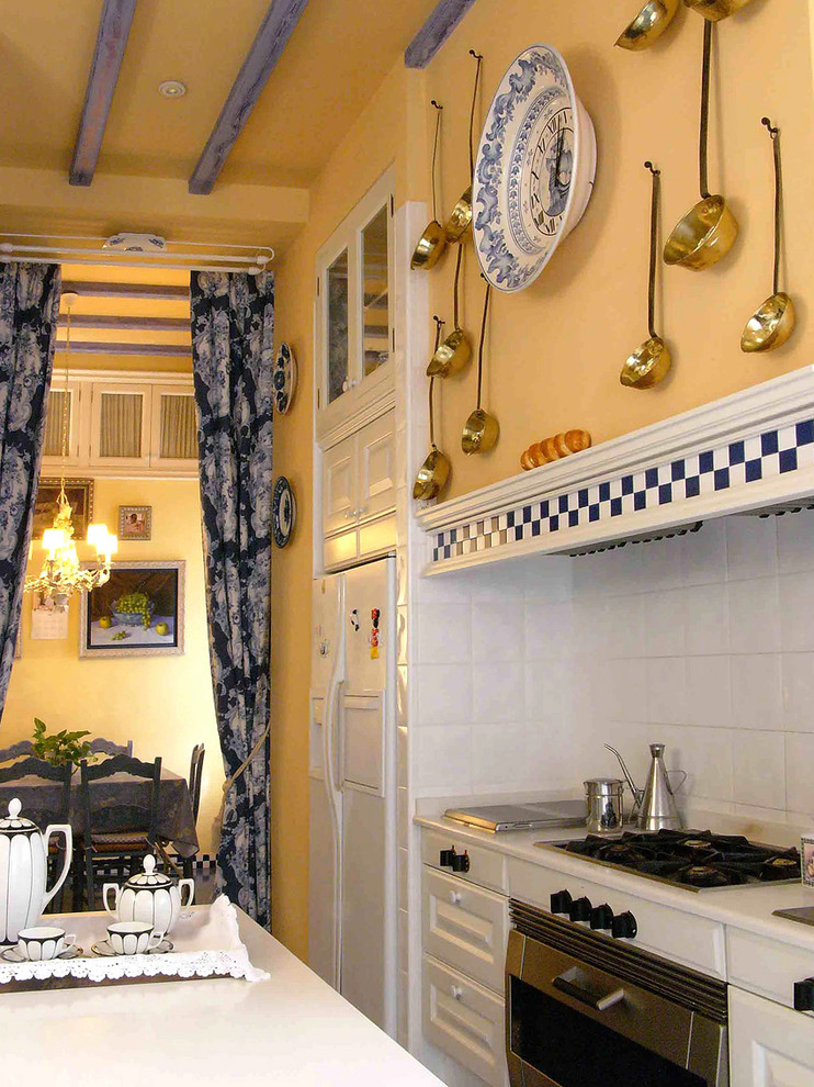 calphalon cookware Kitchen Traditional with artwork blue and white checkerboard blue and white china blue beams copper