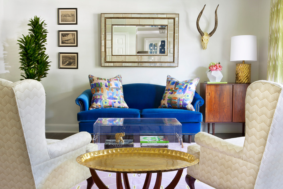 camelback sofa Living Room Contemporary with animal skull blue velvet brass lamp Brass Tray Table chevron fabric gold