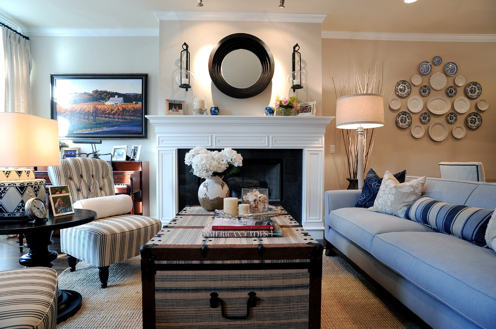 Candle Sconces Living Room Traditional with Blue and White Blue Couch Crown Molding Fireplace Round Mirror Striped Armless