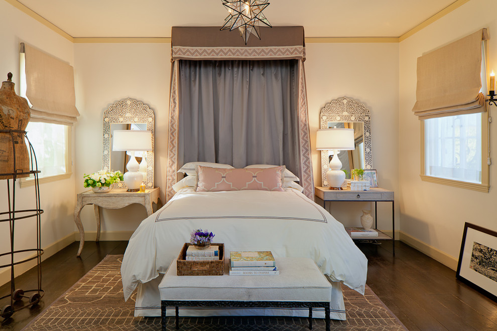 candle wall sconces Bedroom Mediterranean with area rug baseboards bed crown bed pillows bedside table canopy bed dark