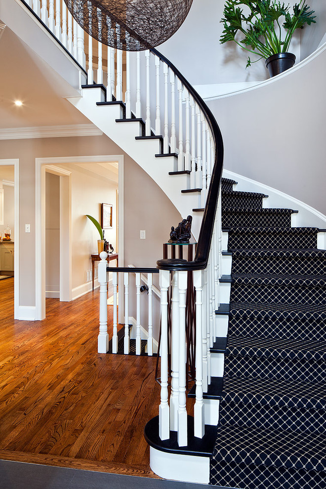 carpet stair treads Staircase Contemporary with baseboards black treads curved staircase landing runner spindle banister white trim white