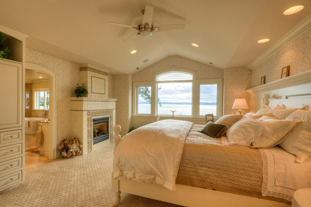 Carpet Sweepers Bedroom Traditional with Arched Doorway Ball Finial Carpeting Ceiling Fan Crown Molding Feminine Fireplace Ledge