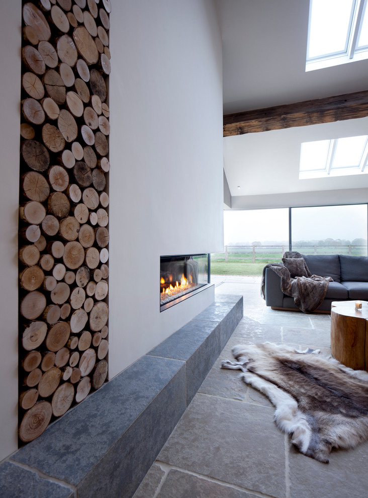 Ceramic Fireplace Logs Living Room Contemporary with Animal Hide Rug Barn Conversion Interior Cathedral Ceiling Exposed Wood Beams Firewood