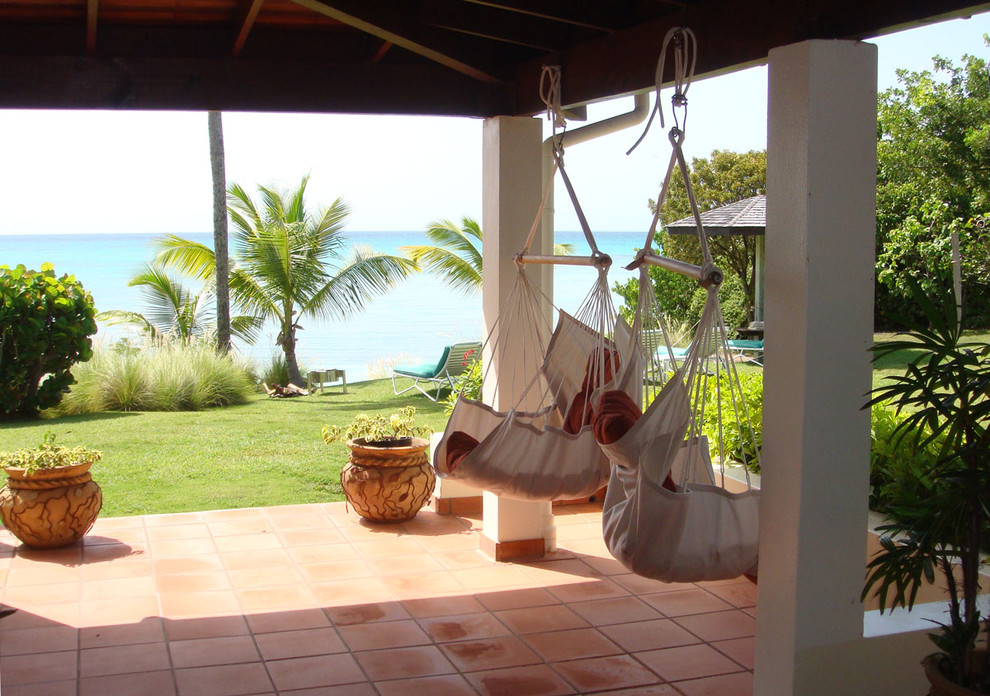 chair hammock Patio Tropical with hanging chair lanai ocean terra cotta terrace tile floor waterfront