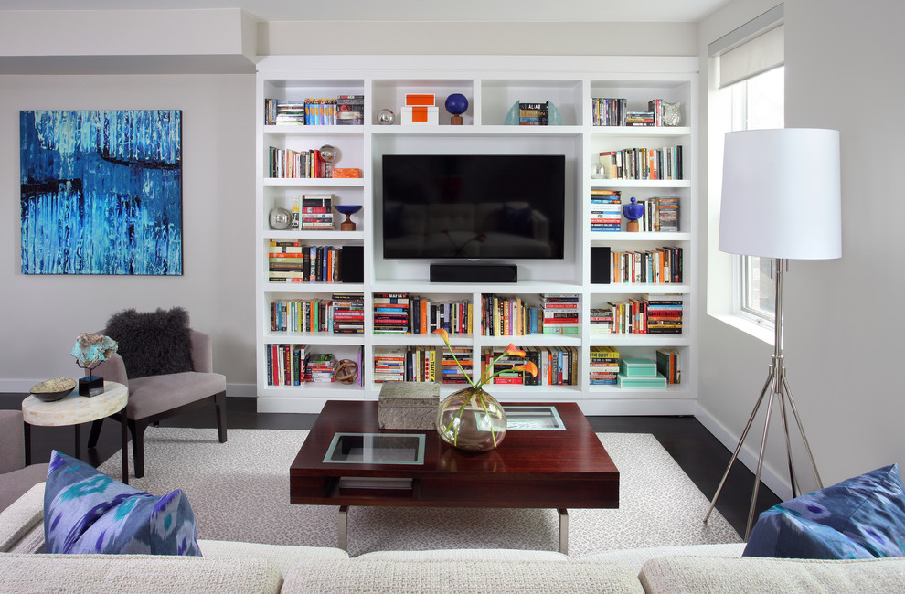 Chaise Lounge Chair Family Room Contemporary with Area Rug Artwork Baseboards Bookcase Bookshelves Built in Shelves Colorful Books Dark Floor
