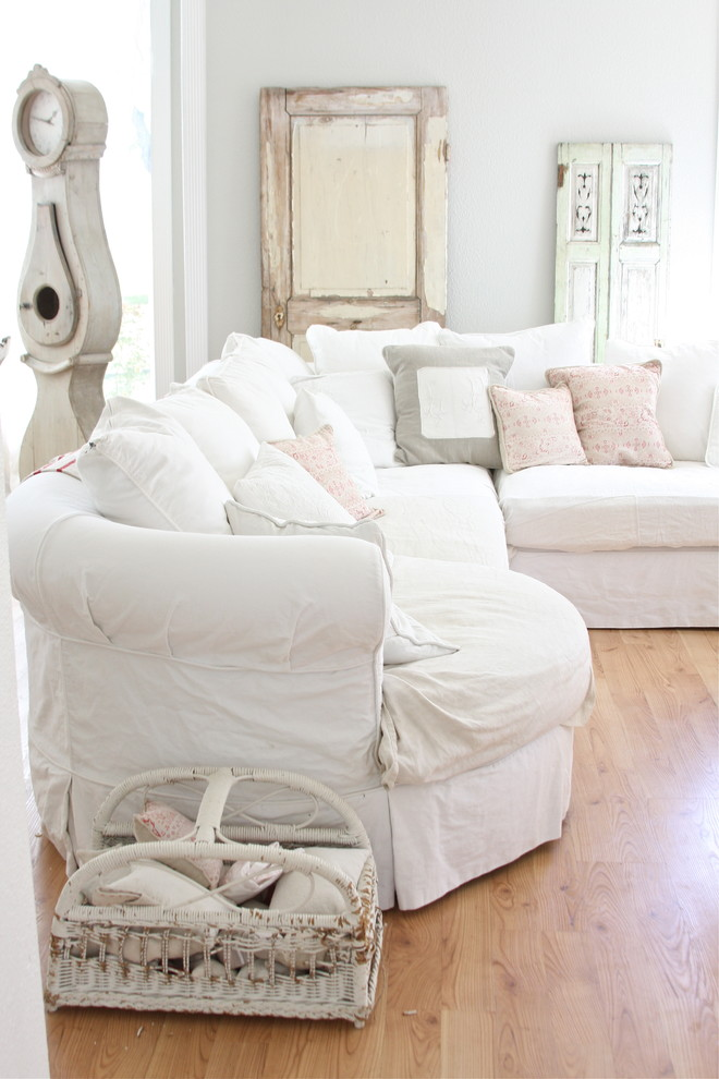 cheap couch covers Living Room Shabby chic with basket flea sofa French grandfather clock hardwood floors Parisian shabby chic slipcover