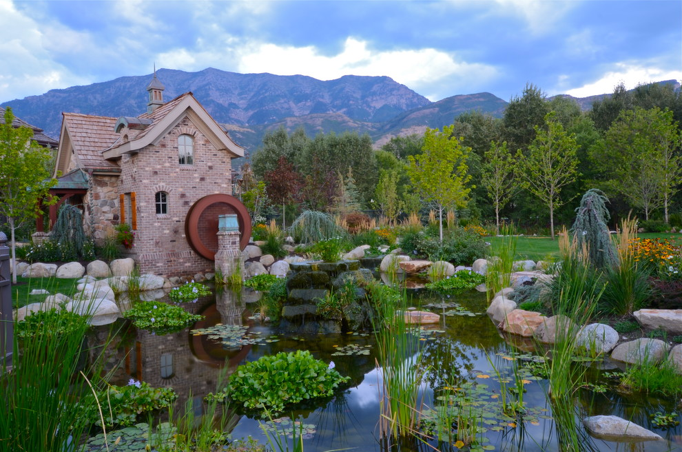 Childrens Playhouses Landscape Traditional with Arched Window Boulder Landscape Brick Exterior Brick Siding Cupola Fairytale Grass Koi