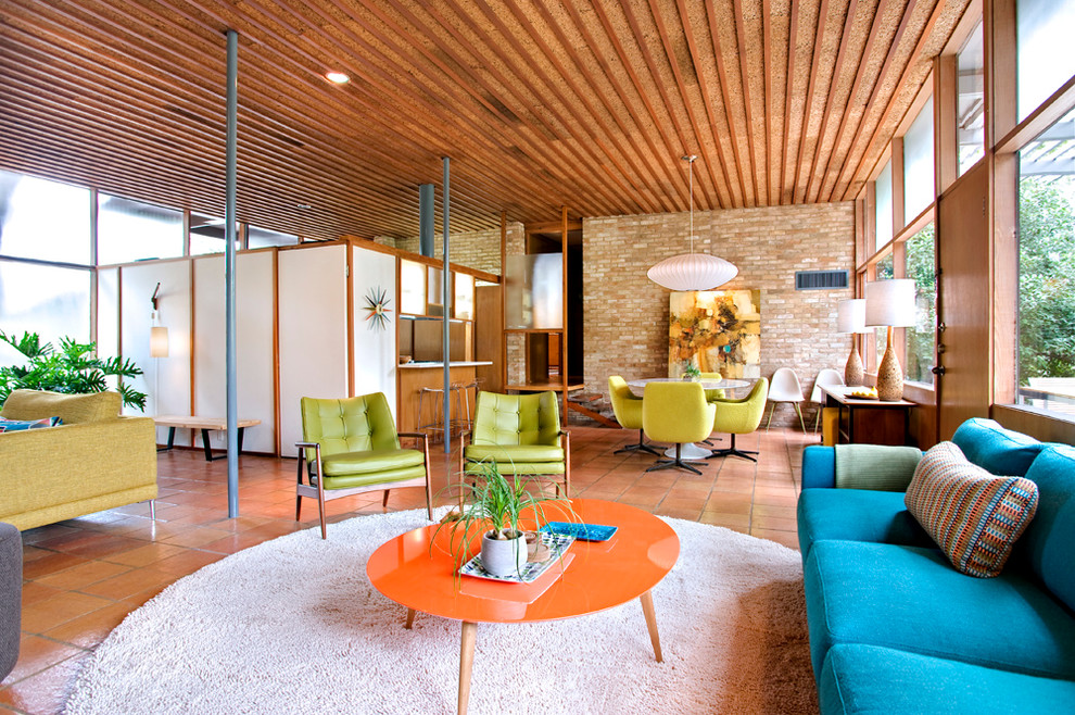 Circular Rugs Family Room Midcentury with Beige Rug Brick Wall Bright Blue Sofa Bright Green Chair Bright Green