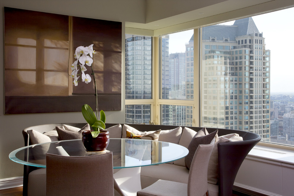 Circular Sofa Dining Room Modern with Artwork Banquette Corner Windows Glass Dining Table High Rise Neutral Colors Orchid