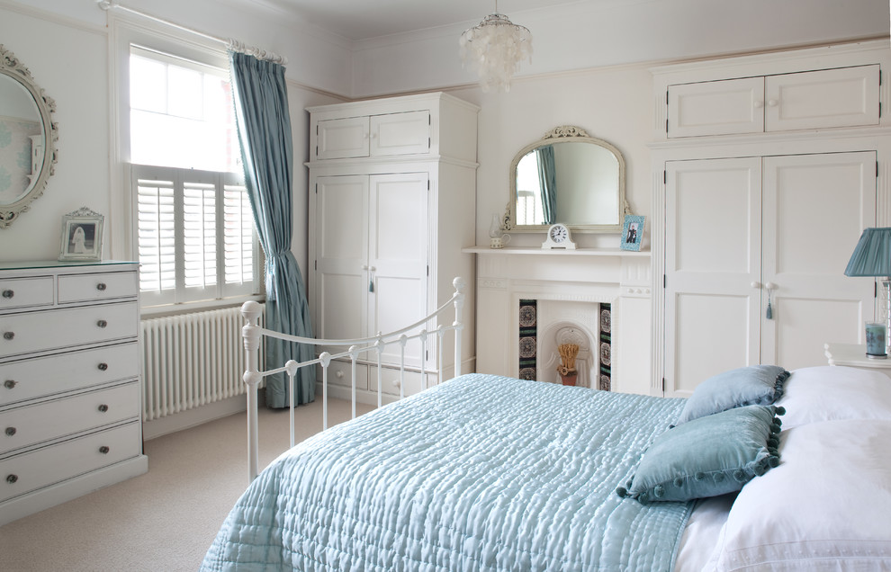 clothing armoire Bedroom Traditional with bedding blue chandelier dresser mantel mirror wardrobe white bed window