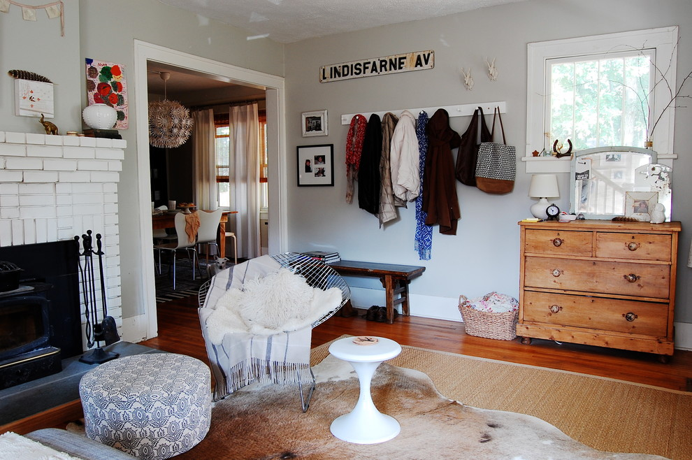Coat Rack Bench Living Room Eclectic with Animal Rug Bench Black Patterned Ottoman Brick Fireplace Coat Hook Coat Rack
