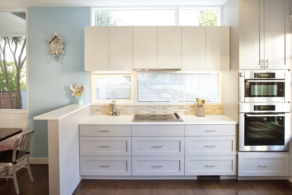 Coo Coo Clock Kitchen Contemporary with Blue Wall Modern Kitchen Shaker Kitchen White Kitchen Cabinet Window Wood Floor