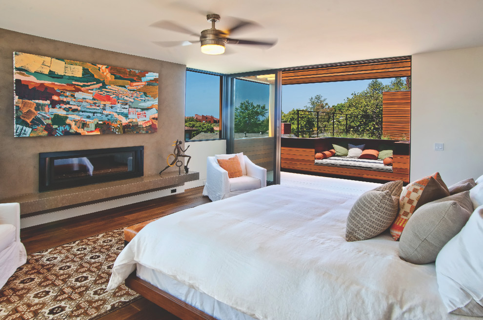 Coral Comforter Bedroom Contemporary with Area Rug Art Artwork Balcony Bedroom Bedroom Fireplace Brown Ceiling Fan Deck