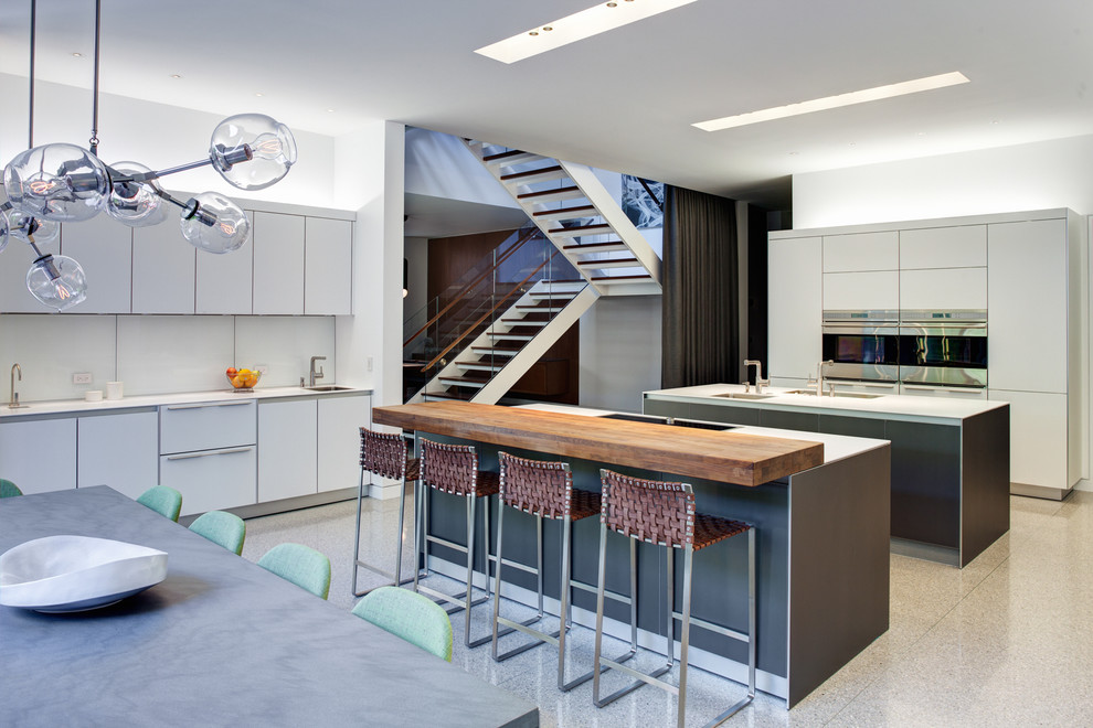counter stools with backs Kitchen Industrial with bulthaup eat-in kitchen glass globe chandelier industrial island Lindsey Adelman modern staircase